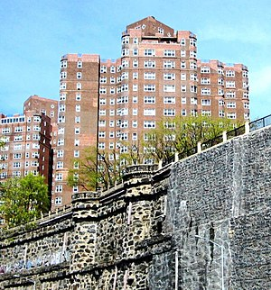 Castle Village - The retaining wall rebuilt; the new section is to the right