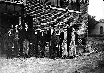 Child shoe workers in Kirksville, Missouri, 1910. Photographed by Lewis Hine as part of the Progressive Era fight against child labor. Child workers in Kirksville, MO.jpg