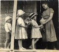 Children give flowers to a teenage girl in a village in Ontario, 03Q P907P06.tiff