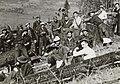 Civilian Conservation Corps men on hillside eating (6289817712).jpg