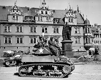 M3 Stuart - Crews from Company D, 761st Tank Battalion, stand by awaiting call to clean out scattered Nazi machine gun nests in Coburg, Germany