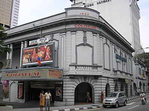Coliseum Theatre (Kuala Lumpur) - The Coliseum Theatre is one of a handful of remaining pre-war cinemas in Kuala Lumpur that still plays films, as of 2010. Two-storey shop buildings housing the Coliseum Café and Hotel are seen in the background, on the right.