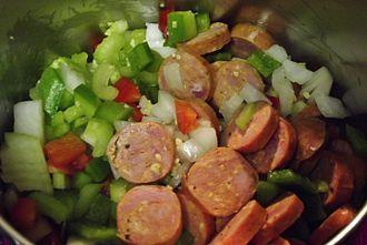 Jambalaya - Ingredients for jambalaya in a pot beginning to cook.