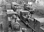 "Cork, Albert Quay: CIE steam locomotives stored outside the ex-CB station. Out-of-service tank engines of various classes and wheel arrangements stored near the former CB station, which was closed on 1 April 1961. The locomotive farthest from the camera on the right is no. 41; a 2-4-2T of the former GS ""33 Class"" of 1892-94, which the GSR reclassified ""F6"". The locomotive farthest from the camera in the middle siding is an 0-6-0T of the former GS possibly one of the ""201 Class"" of 1887-1901, which the GSR reclassified ""J11"". [Expert opinion needed on the engines depicted]. [Precise location also uncertain]."