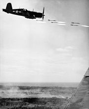 F4U Corsair fighter firing rockets in the support of the troops on Okinawa.