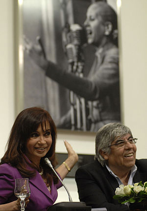 Hugo Moyano - President Cristina Fernández de Kirchner and Hugo Moyano share the stage beneath an image of former First Lady Eva Perón. The alliance of Moyano and Kirchnerism was a centerpiece of Argentine political life during her first term.