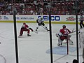 Crosby about to make a pass for a goal (3569764445).jpg