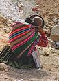 Crouching woman and child Peru.jpg