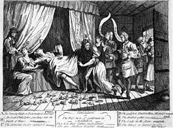 "A woman apparently in labour lies on a tester bed, her legs dangling over the edge.  Rabbits are on the floor beneath her, some in parts.  A nurse is seated to the left, and to the extreme left a man stands, partially hidden by a curtain.  A man wearing a wig has his right arm beneath the woman's skirts, to the right one man says ""A Sooterkin"", another says ""A great birth"".  Near a door on the right of the image, a man says ""It's too big"" to another man stood in the doorway, holding a rabbit.  Rows of text at the bottom describe the people in the image."