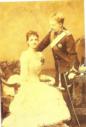 D. Carlos I com a Rainha D. Amélia em 1887, assinada pelos dois.png