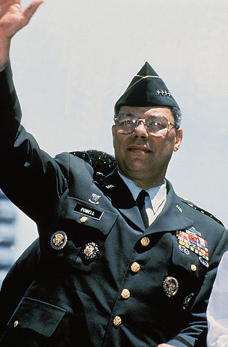 Colin Powell - General Colin Powell, Chairman, Joint Chiefs of Staff, waves from his motorcade during the Persian Gulf War Welcome Home Parade in New York City.