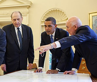 Dallin H. Oaks - Oaks (right) with LDS Church president Thomas S. Monson (left) and U.S. President Barack Obama (center) in the Oval Office on 20 July 2009, presenting a personal volume of President Obama's family history as a gift from the LDS Church.
