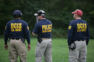 Defense Criminal Investigative Service - DCIS special agents participate in firearms training at FLETC.