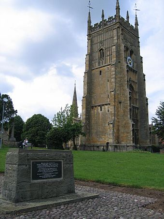 Memorial stone, erected in 1965, on the site of de Montfort's grave at Evesham Abbey in Worcestershire. De montfort evesham.jpg