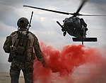Defense.gov News Photo 111205-F-LH638-919 - Maj. Matthew McGuinness pops a flare to signal an HH-60G Pave Hawk where to land during Exercise Cope Angel 12 Dec. 5 2011 in Okinawa Japan. The.jpg