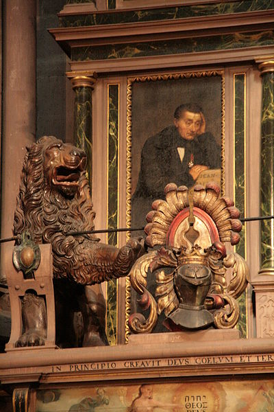 File:Detail of the astronomical clock of Strasbourg with portrait of clockmaker Jean-Baptiste Schwilgué in the background.jpg
