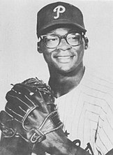 Photograph of Dick Allen the Phillies' third baseman and outfielder, posed with his glove in front of his chest