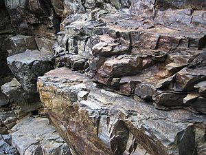 Rock (geology) - Rock outcrop along a mountain creek near Orosí, Costa Rica.