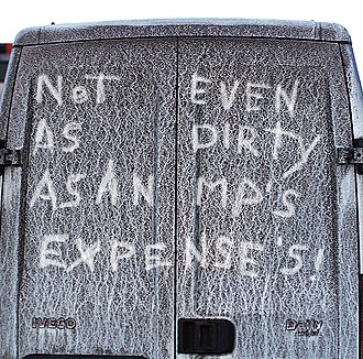 Reverse graffiti - A message written in dirt on the back of a van
