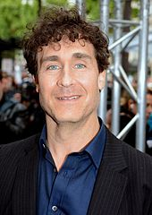 Doug Liman in front of a steel beam.