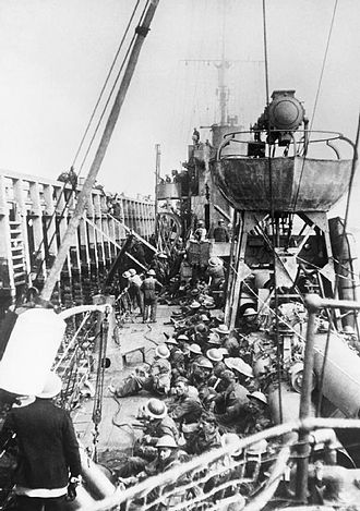 HMS Vanquisher (D54) - Troops use scaling ladders to board Vanquisher from the mole at Dunkirk
