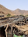 Dwellings with Mountain Backadrop - En route from Gondar to Shire - Tigray Province - Ethiopia (8699574028).jpg