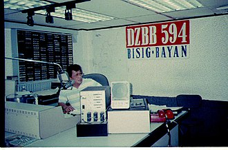 DZBB-AM - Arman Roque during his radio program in the early 1990s