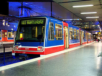 Docklands Light Railway rolling stock - P86 stock with original DLR livery at Essen Hauptbahnhof station, 2005