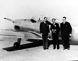 Edgar Schmued - The NA-35 (later Vega 35) is shown at NAA's facility, with Edgar Schmued standing at the right.