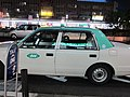 Een Meitetsu taxi wacht op passagiers bij de westelijke ingang van station Kōnan, -4 mei 2012.jpg