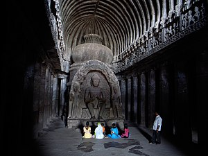 "Rock-cut architecture - The Buddhist ""Carpenter's Cave"", a chaitya hall at Ellora in Maharashtra, India."