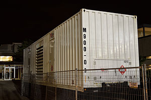 Emergency power system - A portable emergency power generator in a shipping container