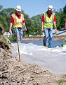 Engineers monitor a temporary emergency levee.jpg