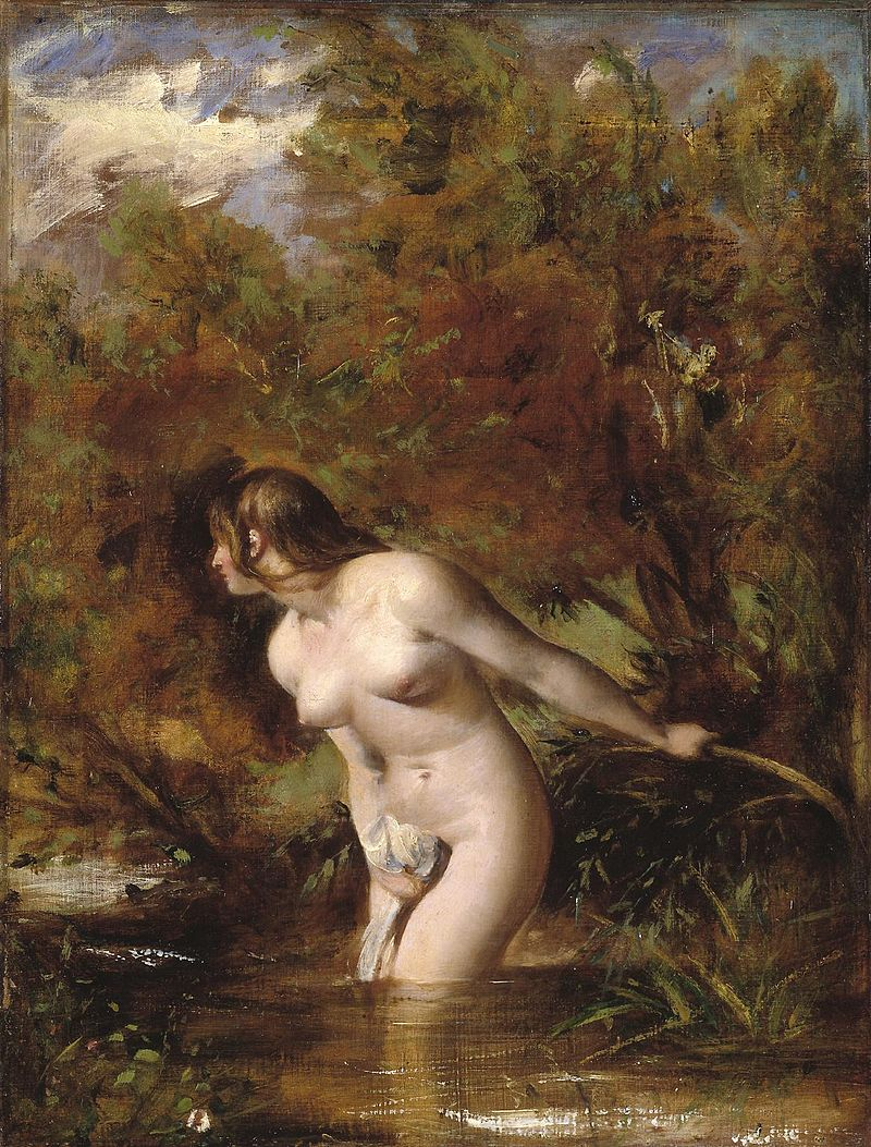 Naked woman standing in a stream