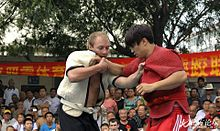 Two Shuai Jiao wrestlers testing each other in Tianjin, China.
