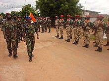 New Forces general Bakayoko reviews his troops who are standing at attention in regularized uniforms
