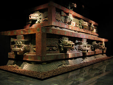 Restored portion of Teotihucan architecture showing the typical Mesoamerican use of red paint complemented on gold and jade decoration upon marble and granite. Facade of the Temple of the Feathered Serpent (Teotihuacan).jpg