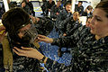 Flickr - Official U.S. Navy Imagery - Sailor teaches shipmates how to wear a protective mask..jpg
