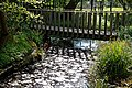 Footbridge over Turkey Brook at Myddelton House, Enfield, London, England.jpg