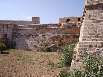 Fort Chambray - Curtain wall between the main gate (left) and St. Paul Bastion