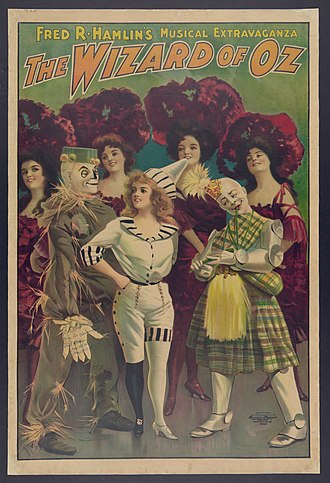 The Wizard of Oz (1902 musical) - One of many promotional posters for the show, featuring The Scarecrow, Dorothy, the Tin Woodman (in a Scottish kilt and minus his funnel hat), and some Poppies