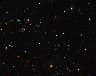Great Observatories Origins Deep Survey - Image: GOODS field containing distant dwarf galaxies forming stars at an incredible rate
