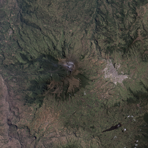 Galeras - The Galeras Volcano, aerial image by NASA showing its activity. City of Pasto on the right.