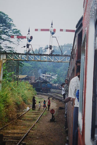 Railway signalling - Railway infrastructure on the hill-country main line, Sri Lanka, including a gantry of semaphore signals