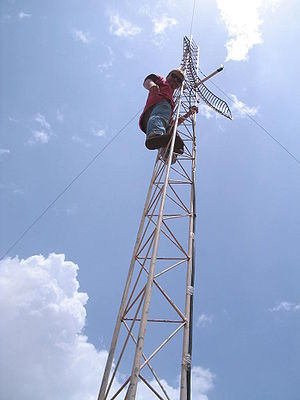 Information and communication technologies for development - A Geekcorps volunteer setting up a Wi-Fi antenna in Mali