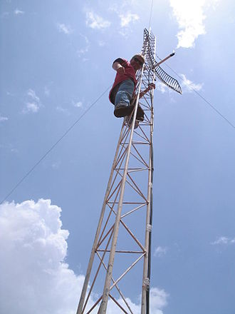 Geekcorps - A Geekcorps volunteer setting up a Wi-Fi antenna in Mali