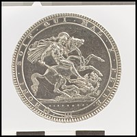 silver coin with St George and the Dragon as the central element