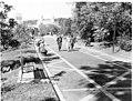 Grand Promenade brick pavement; pedestrians & bench-sitters on the south section (5def2176-7677-4cbd-a8a3-0c275c654f7f).jpg