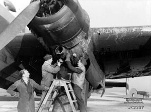 RAF Driffield - Australian ground crew working on one of No. 462 Squadron's Halifax bombers in December 1944