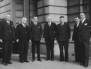 Peter Fraser (New Zealand politician) - Group portrait photograph taken at a gathering of Cabinet ministers in 1941. Fraser is standing in the centre.
